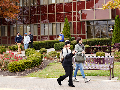 Photo of students walking in front of the Fulmer Center building