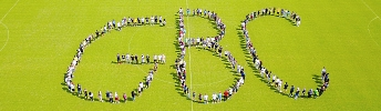 Photo of GBC students on soccer field arranged as letters GBC