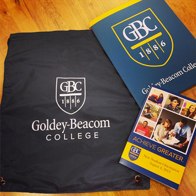 Instagram photo of GBC bag, folder, and new student orientation card
